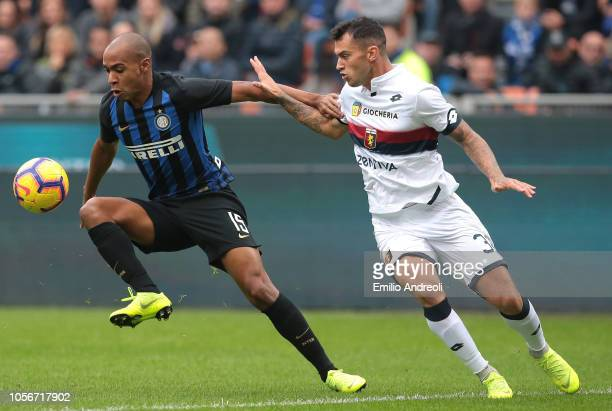 Joao Mario of FC Internazionale is challenged by Pedro Pereira of Genoa CFC during the Serie A match between FC Internazionale and Genoa CFC at...