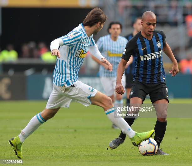 Joao Mario of FC Internazionale is challenged by Simone Missiroli of Spal during the Serie A match between FC Internazionale and SPAL at Stadio...