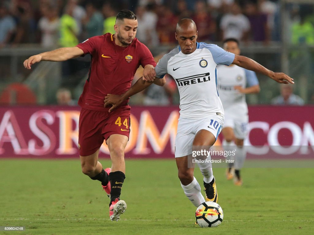 Joao Mario of FC Internazionale Milano (R) competes for the ball with Kostas Manolas of AS Roma during the Serie A match between AS Roma and FC Internazionale on August 26, 2017 in Rome, Italy.
