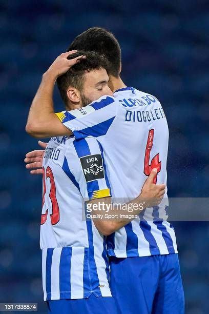 Joao Mario of FC Porto celebrates with Diogo Leite after scoring his team's fifth goal during the Liga NOS match between FC Porto and SC Farense at...