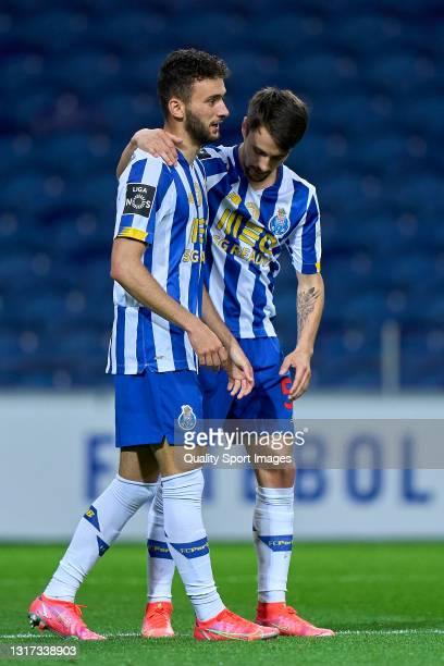 Joao Mario of FC Porto celebrates with Fabio Vieira after scoring his team's fifth goal during the Liga NOS match between FC Porto and SC Farense at...