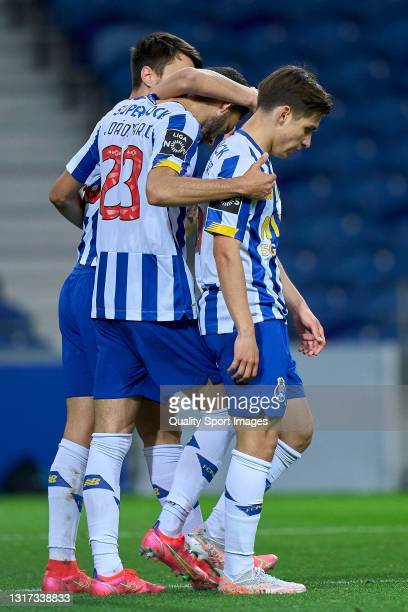 Joao Mario of FC Porto celebrates with Francisco 'Chico' Conceicao and Fabio Vieira after scoring his team's fifth goal during the Liga NOS match...