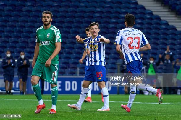 Joao Mario of FC Porto celebrates with his team mates after scoring his team's fifth goal during the Liga NOS match between FC Porto and SC Farense...