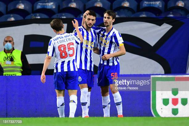 Joao Mario of FC Porto celebrates with teammates after scores his sides fifth goal during the Liga NOS match between FC Porto and SC Farense at...