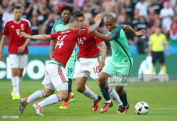 Joao Mario of Portugal and Gergo Lovrencsics of Hungary compete for the ball during the UEFA EURO 2016 Group F match between Hungary and Portugal at...