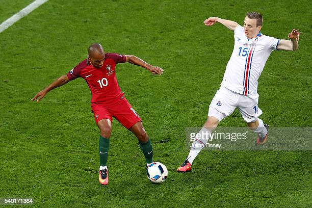 Joao Mario of Portugal and Jon Dadi Bodvarsson of Iceland compete for the ball during the UEFA EURO 2016 Group F match between Portugal and Iceland...