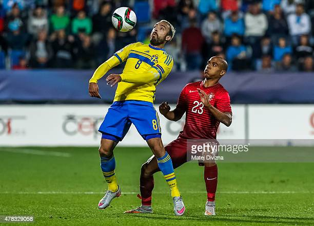 Joao Mario of Portugal battles for the ball with Abdullah Khalili of Sweden during UEFA U21 European Championship Group B match between Portugal and...