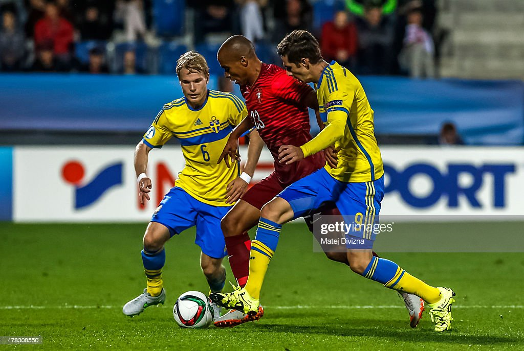 Joao Mario (C) of Portugal battles for the ball with Oscar Lewicki (L) and Branimir Hrgota (R) of Sweden during UEFA U21 European Championship Group B match between Portugal and Sweden at Mestsky Fotbalovy Stadium on June 24, 2015 in Uherske Hradiste, Czech Republic.