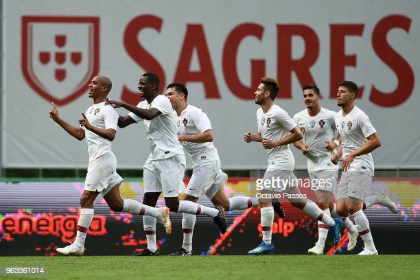 Joao Mario of Portugal celebrates with team mates after scoring the second goal during the international friendly football match against Portugal and...