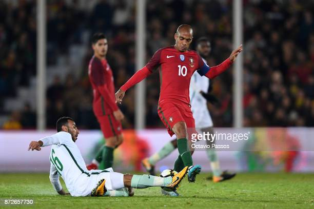 Joao Mario of Portugal competes for the ball with Nouh AlMousa of Saudi Arabia during the International Friendly match between Portugal and Saudi...