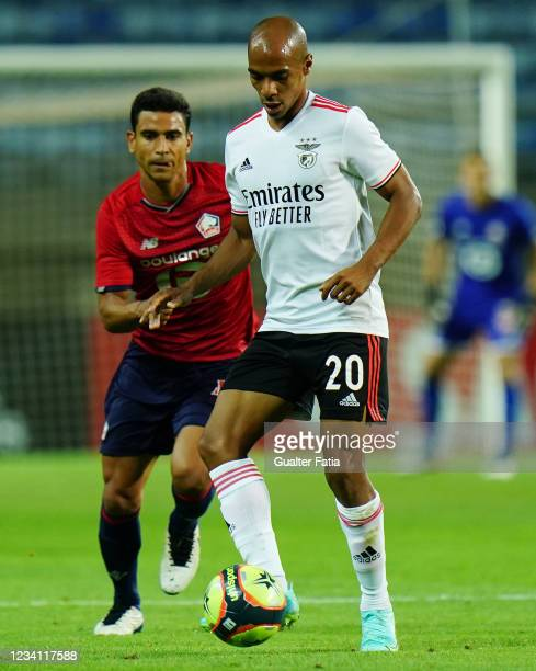 Joao Mario of SL Benfica with Benjamin Andre of LOSC Lille in action during the Pre-Season Friendly match between SL Benfica and Lille at Estadio...