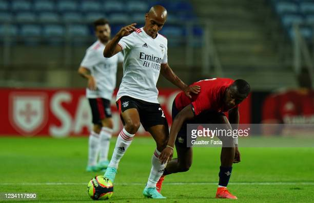 Joao Mario of SL Benfica with Tiago Djalo of LOSC Lille in action during the Pre-Season Friendly match between SL Benfica and Lille at Estadio...