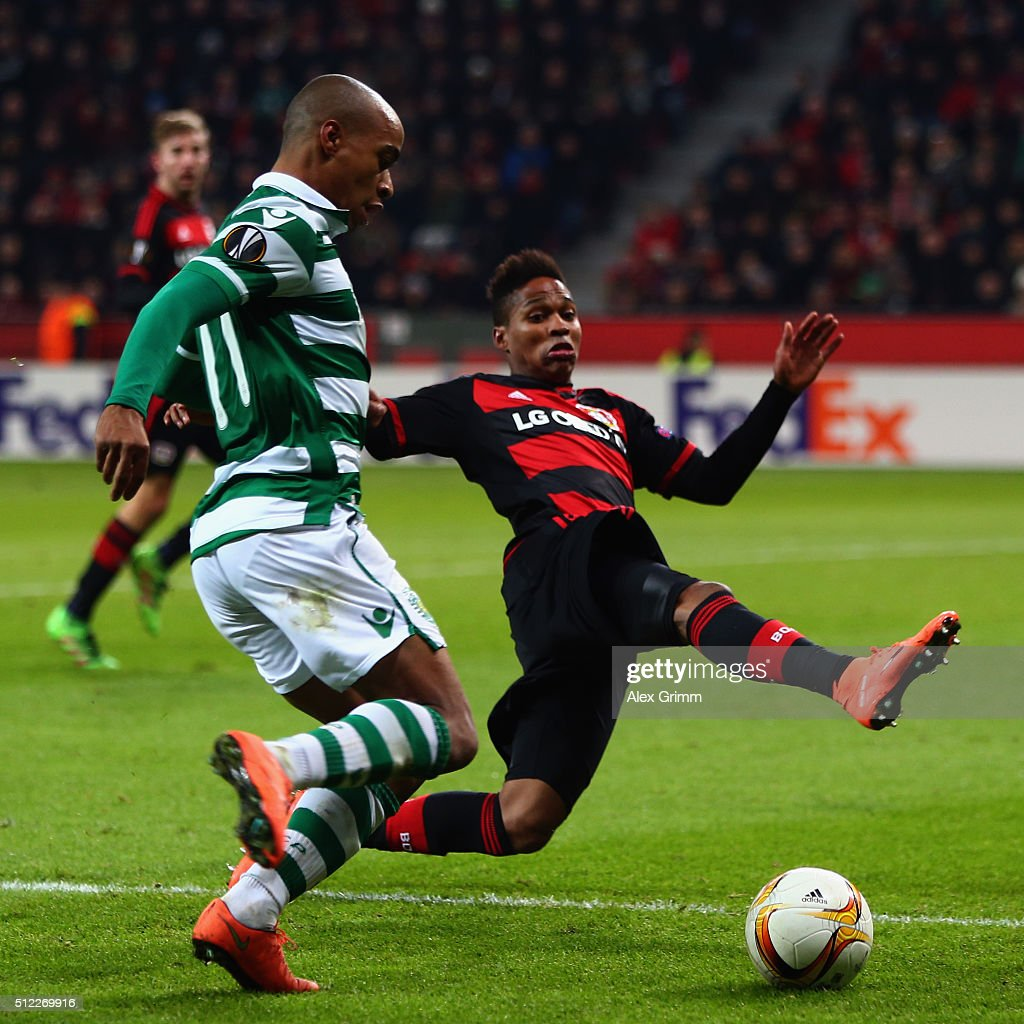 Joao Mario (L) of Sporting is challenged by Wendell of Leverkusen during the UEFA Europa League round of 32 second leg match between Bayer Leverkusen and Sporting Lisbon at BayArena on February 25, 2016 in Leverkusen, Germany.