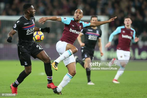 Joao Mario of West Ham in action with Timothy FosuMensah of Crystal Palace during the Premier League match between West Ham United and Crystal Palace...