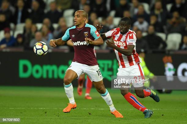 Joao Mario of West Ham United and Badou Ndiaye of Stoke City in action during the Premier League match between West Ham United and Stoke City at...