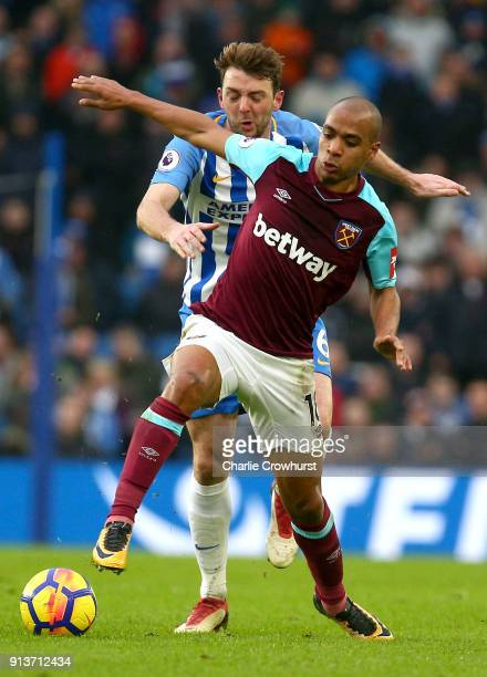 Joao Mario of West Ham United holds off Dale Stephens of Brighton and Hove Albion during the Premier League match between Brighton and Hove Albion...