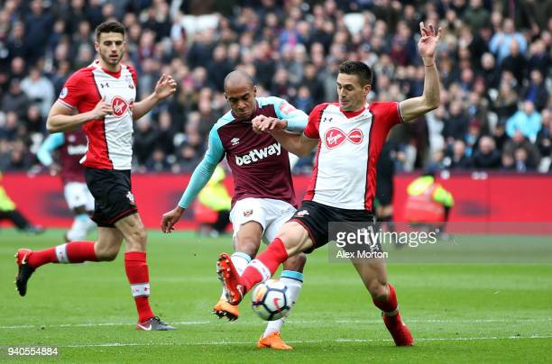 Joao Mario of West Ham United scores his sides first goal during the Premier League match between West Ham United and Southampton at London Stadium...