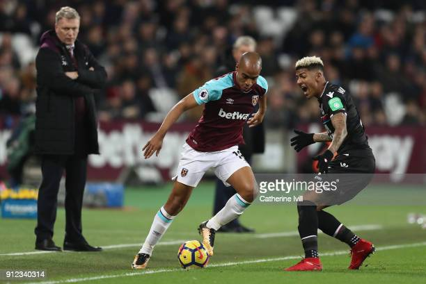 Joao Mario of West Ham United takes on Patrick van Aanholt of Crystal Palace during the Premier League match between West Ham United and Crystal...