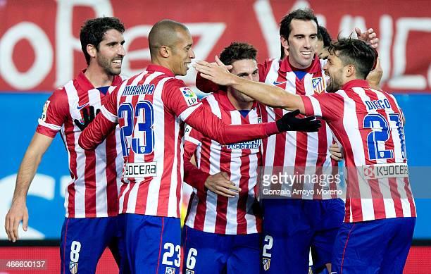 Joao Miranda celebrates scoring their third goal with teammates Diego Ribas Diego Godin Koke and Raul Garcia during the La Liga match between Club...