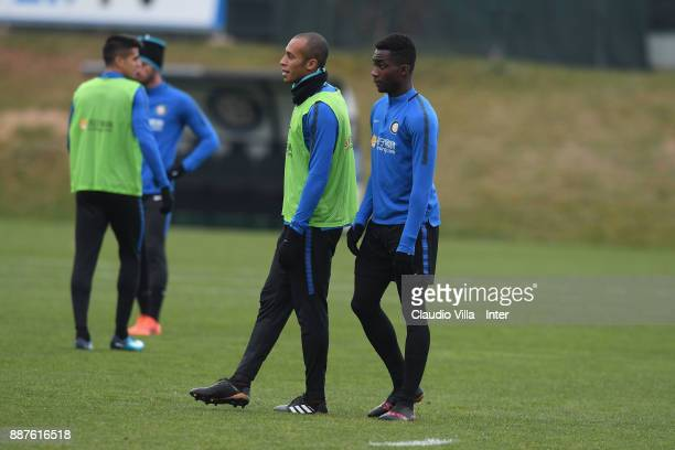 Joao Miranda de Souza Filho and Yann Karamoh of FC Internazionale look on during an FC Internazionale training session at Suning Training Center at...