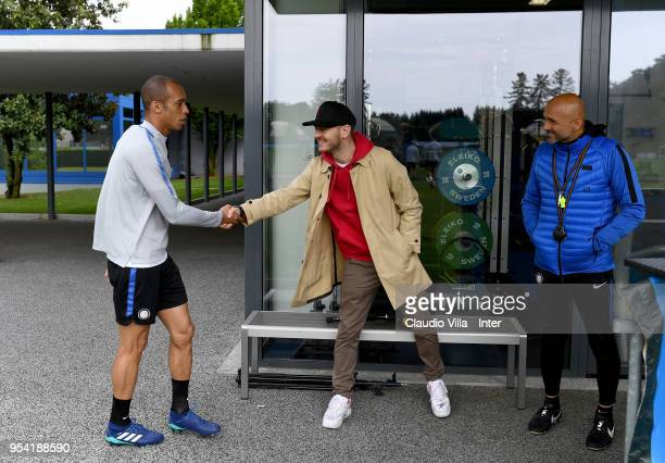 Joao Miranda de Souza Filho of FC Internazionale and Alessandro Cattelan pose for a photo during the FC Internazionale training session at the club's...