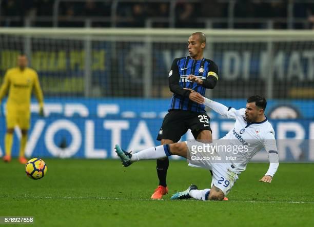 Joao Miranda de Souza Filho of FC Internazionale and Andrea Petagna of Atalanta BC compete for the ball during the Serie A match between FC...
