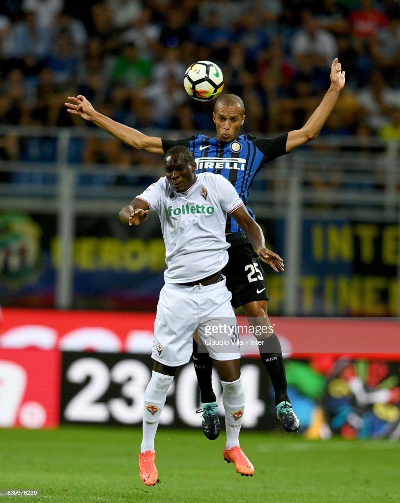 Joao Miranda de Souza Filho of FC Internazionale #25 and Khouma Elhadji Babacar of ACF Fiorentina compete for the ball during the Serie A match between FC Internazionale and ACF Fiorentina at Stadio Giuseppe Meazza on August 20, 2017 in Milan, Italy.