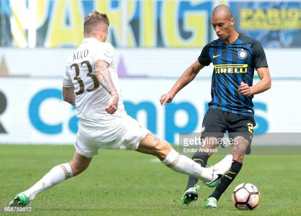 Joao Miranda de Souza Filho of FC Internazionale Milano competes for the ball with Juraj Kucka of AC Milan during the Serie A match between FC...