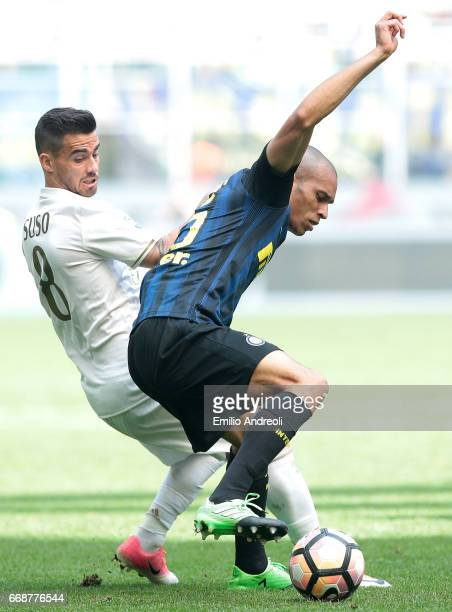 Joao Miranda de Souza Filho of FC Internazionale Milano competes for the ball with Suso of AC Milan during the Serie A match between FC...