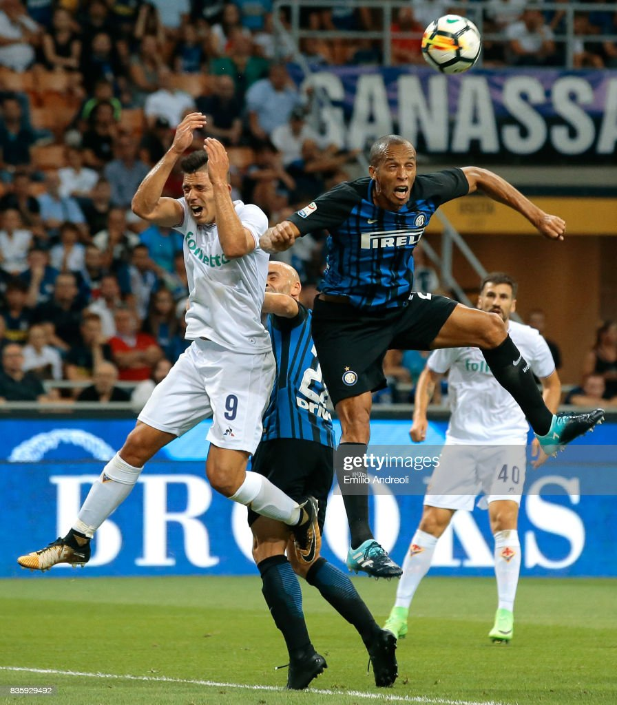 Joao Miranda de Souza Filho of FC Internazionale Milano (R) jumps for the ball with Giovanni Simeone of ACF Fiorentina during the Serie A match between FC Internazionale and ACF Fiorentina at Stadio Giuseppe Meazza on August 20, 2017 in Milan, Italy.