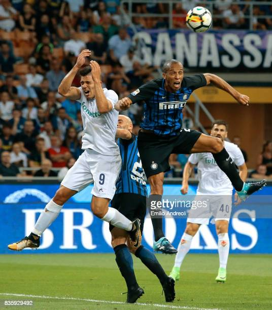 Joao Miranda de Souza Filho of FC Internazionale Milano jumps for the ball with Giovanni Simeone of ACF Fiorentina during the Serie A match between...