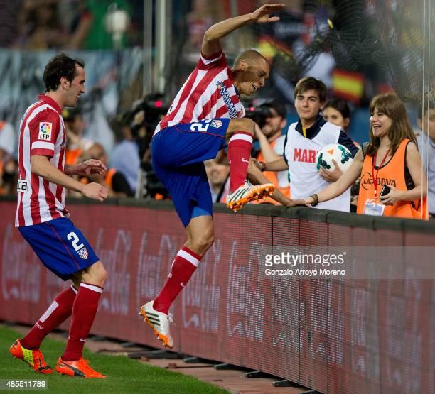 Joao Miranda of Atletico de Madrid jumps the advertising boarding celebrating their opening goal during the La Liga match between Club Atletico de...