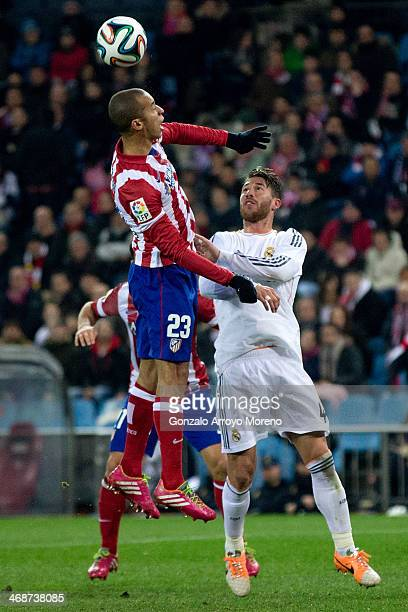 Joao Miranda of Atletico de Madrid wins the header after Sergio Ramos of Real Madrid CF during the Copa del Rey semifinal second leg match between...