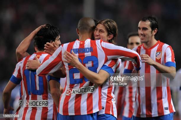 Joao Miranda of Club Atletico de Madrid celebrates with Filipe Luis after scoring his team's 4th goal during the La Liga match between Club Atletico...