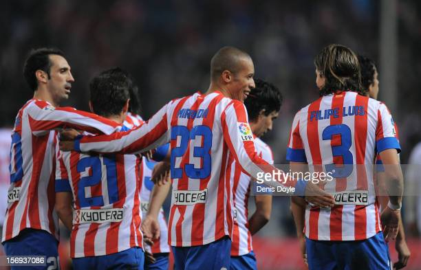 Joao Miranda of Club Atletico de Madrid celebrates with Filipe Luis and Emre Belozoglu after scoring his team's 4th goal during the La Liga match...