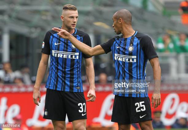 Joao Miranda of FC Internazionale talks with Milan Skriniar of FC Internazionale during the Serie A match between FC Internazionale and Spal at...