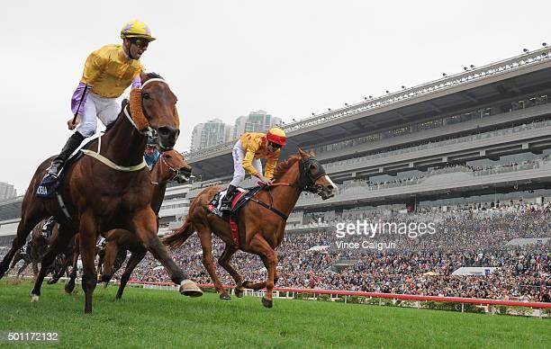 Joao Moreira riding Peniaphobia of Hong Kong defeats Christophe Soumillon riding GoldFun in Race 5 The Longines Hong Kong Sprint during the Hong Kong...