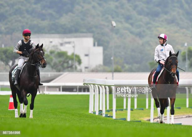 Joao Moreira riding Tosen Basil and Hugh Bowman riding Staphanos during a Longines Hong Kong International Trackwork Session at Sha Tin racecourse on...