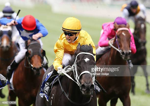 Joao Moriera riding Brazen Beau wins race 4 the Coolmore Stud Stakes on Derby Day at Flemington Racecourse on November 1 2014 in Melbourne Australia