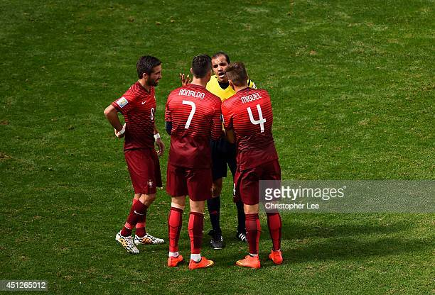 Joao Moutinho Cristiano Ronaldo and Miguel Veloso of Portugal protest to referee Nawaf Shukralla during the 2014 FIFA World Cup Brazil Group G match...