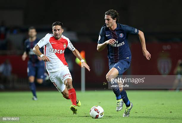 Joao Moutinho of Monaco and Adrien Rabiot of PSG in action during the French Ligue 1 match between AS Monaco and Paris SaintGermain at Stade Louis II...