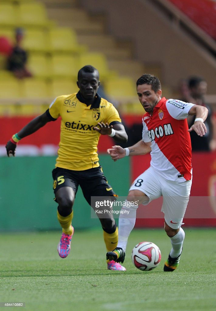 Joao Moutinho of Monaco and Idrissa Gueye of Lille compete for the ball during the French Ligue 1 match between AS Monaco FC and LOSC Lille at Louis II Stadium on August 30, 2014 in Monaco, Monaco.