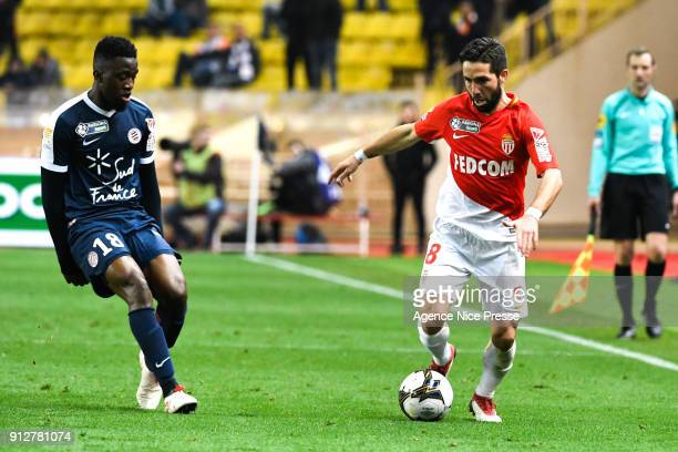 Joao Moutinho of Monaco and Isaac Mbenza of Montpellier during the League Cup semi final match between Monaco and Montpellier at Stade Louis II on...