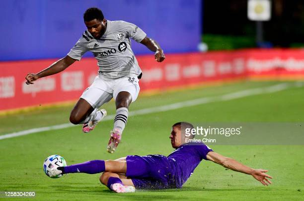 Joao Moutinho of Orlando City slides to defend the ball from Orji Okwonkwo of Montreal Impact in the first half of their game during the knockout...