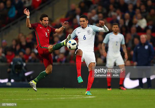 Joao Moutinho of Portugal and Chris Smalling of England during the International Friendly match between England and Portugal at Wembley Stadium on...