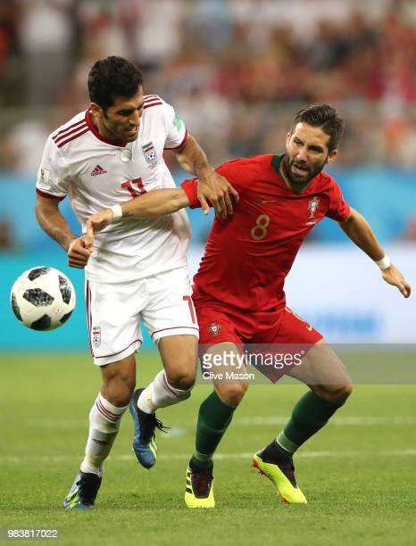 Joao Moutinho of Portugal and Vahid Amiri of Iran in action during the 2018 FIFA World Cup Russia group B match between Iran and Portugal at Mordovia...