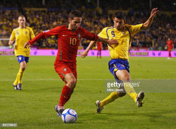Joao Moutinho of Portugal is challenged by Behrang Safari of Sweden during the FIFA 2010 World Cup European Group 1 Qualifier between Sweden and...