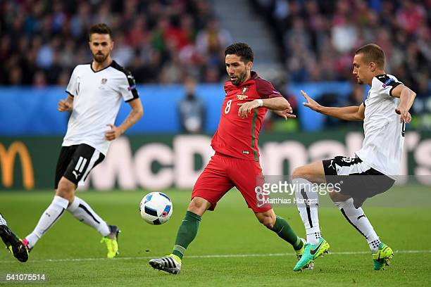 Joao Moutinho of Portugal is chased by Stefan Ilsanker of Austria during the UEFA EURO 2016 Group F match between Portugal and Austria at Parc des...