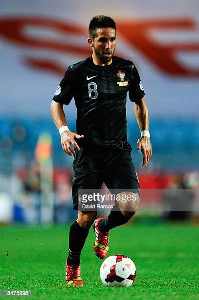 Joao Moutinho of Portugal runs with the ball during the FIFA 2014 World Cup Qualifier match between Portugal and Luxembourg at Estadio Cidade de...