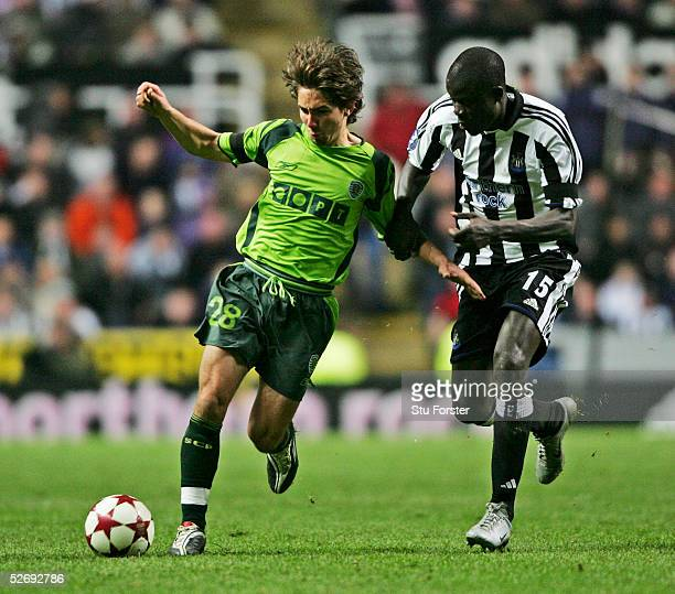 Joao Moutinho of Sporting Lisbon battles with Amdy Faye of Newcastle United during the the UEFA Cup Quarter Final first leg between Newcastle United...